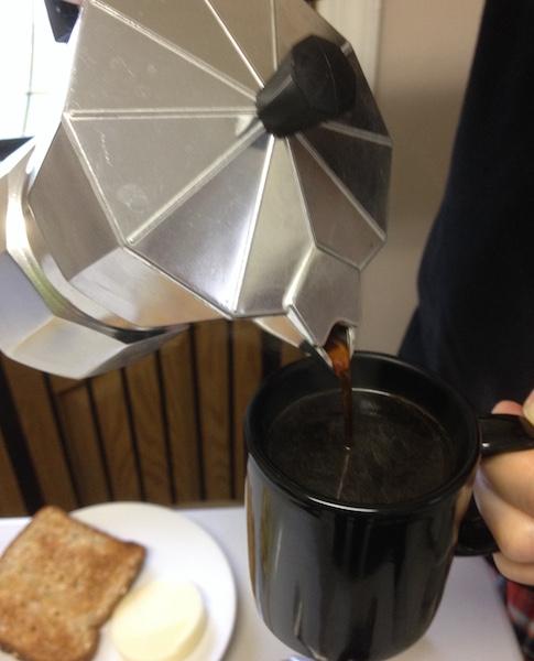 Pour espresso into a 3.5 oz. espresso cup